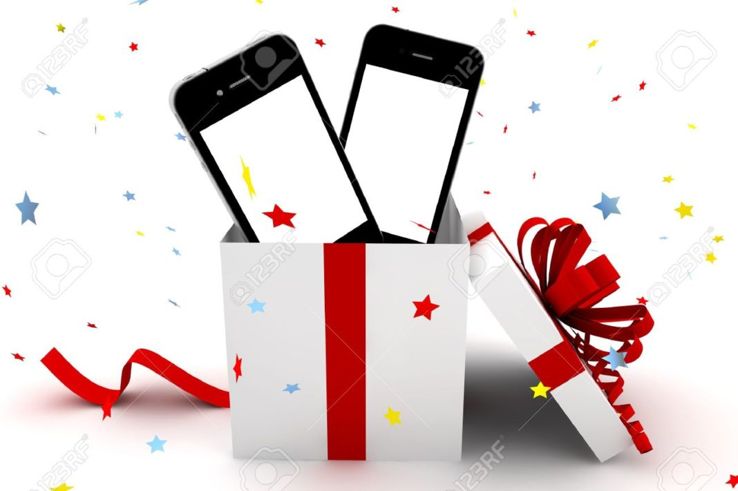 mobile-phones-with-white-screen-inside-a-gift-stock-photo-phone