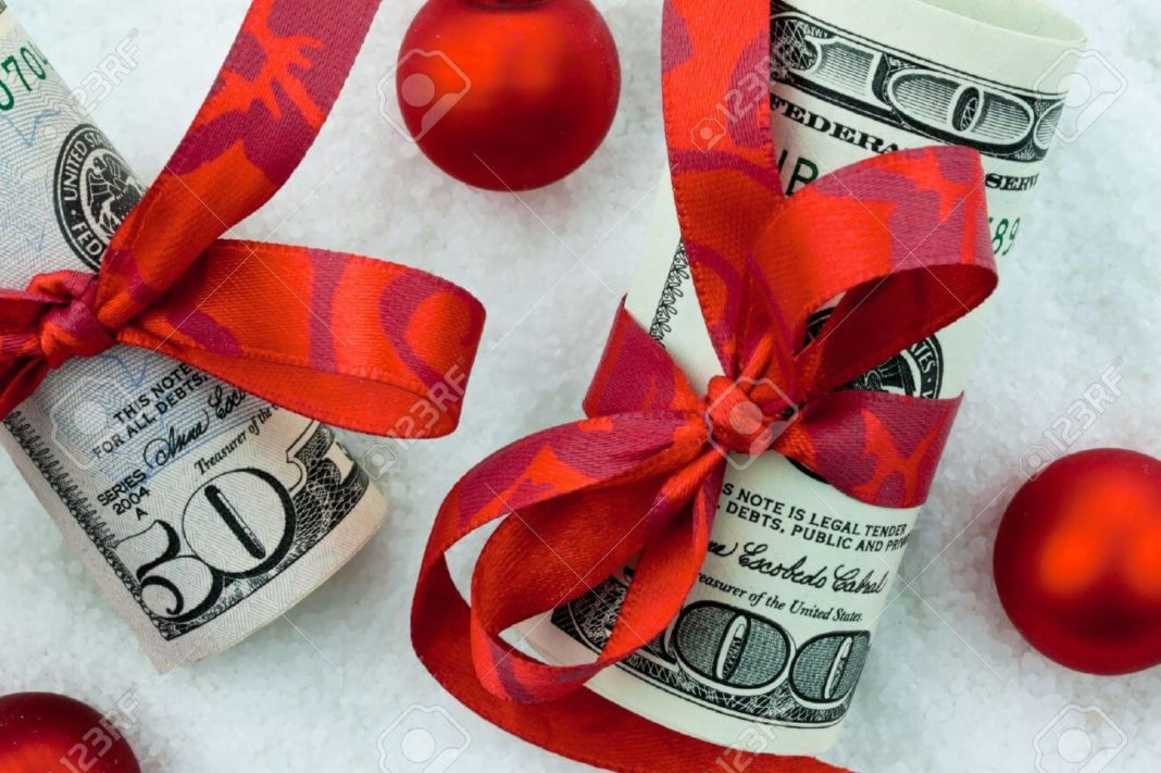 14359467-us-dollars-banknotes-with-ribbon-as-a-cash-gift-for-christmas-stock-photo